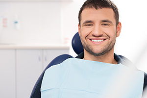 Smiling Man in Dental Office